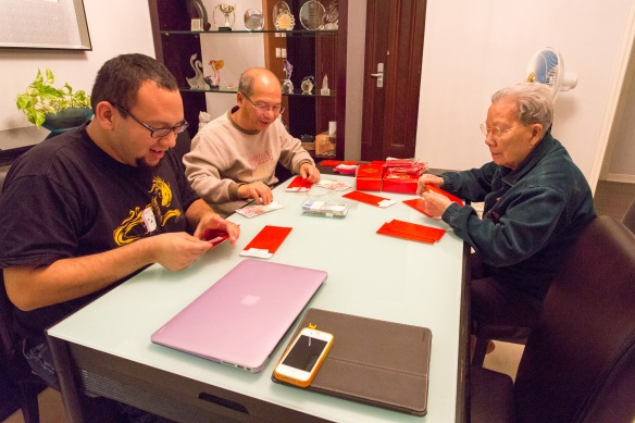 Bryan was putting money in red pockets w/ my dad & grandma.